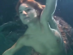Redhead swimming in a dress is cute
