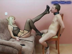 Mistress in fishnets and her slave in collar