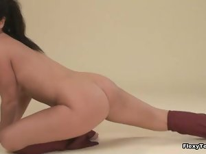 Girl in shiny dance outfit strips solo