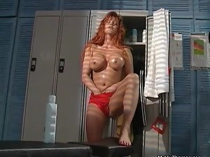 Sexy redhead babe going crazy rubbing her huge tits and her wet pussy