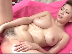 Masturbating Japanese girl is all oiled up