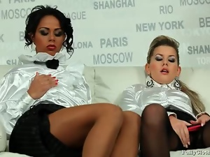 Champagne drinking girls in white satin blouses