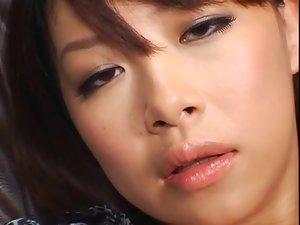 Sensual japanese lady masterbates through panty hose.