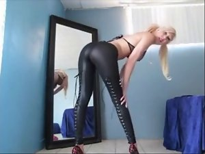 Attractive blond cougar exposes her naughty butt in stiff pants
