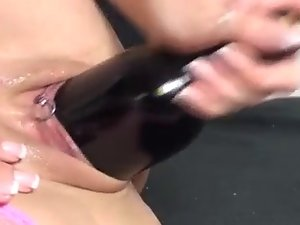 Sensual Mommy bangs herself with a bottle