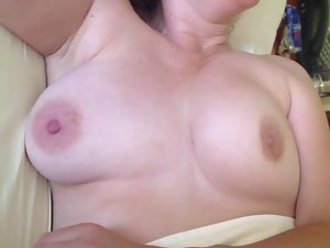 showing off and caressing wife's breasts after wake-up