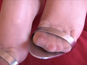 Luscious feet in metal heels