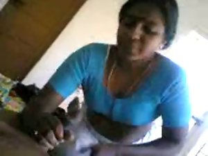 Southindian Aunty handjob and Cock sucking to her Partner's Phallus