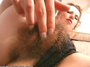 Rubbing her very hairy quim