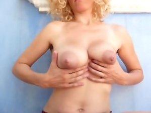 Kinky Mama Milking her Knockers