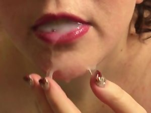 Slutwife accepts a shot of cum from a glass, and plays with the fuckcream