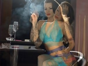 Tattooed actress smoking strong cigarettes in lingerie