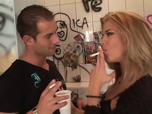 Blond smoking in bathroom