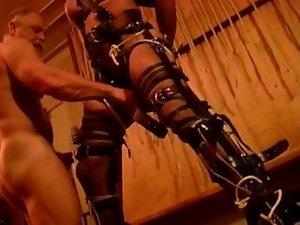 Bound like a prisoner,gets balls bashed.