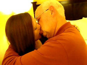 Attractive Wench kissing a 82 year aged man