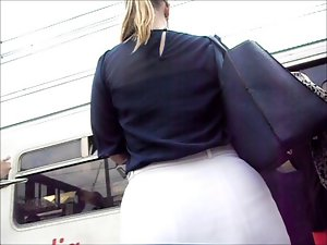 Great blond with big round butt in stiff white skirt