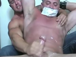 A Meaty Bodybuilder is Tied Up and Jerked by His Gym Buddy