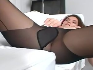 Comely dark haired with mega big melons teasing and rubbing her slit in pantyhose