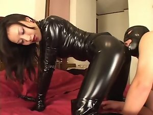 Mistress Reiko in luscious catsuit with her slave