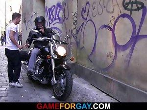 Lewd looking biker is seduced by a gay