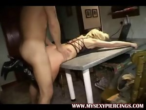 Pierced seductive mom in boots riding younger fellows shaft