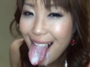 Gorgeous seductive japanese young woman with long tongue caresses and collect cum