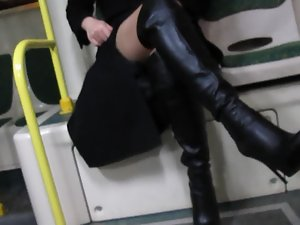 Girlie in stockings and black leather boots flashing in a bus