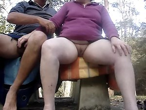 Masturbating together outdoors on a dewy day