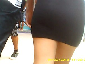Brazilian chick with her guy walking in ebony skirt...