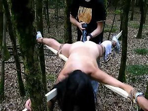 Tied to a cross and shagged with a big rubber toy in the forest