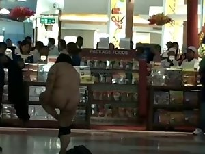 Asian female nude inside airport