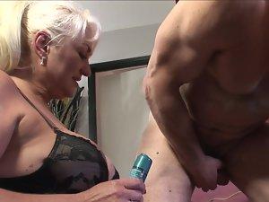 A fatty blond granny is getting banged by a 18yo man on the sofa