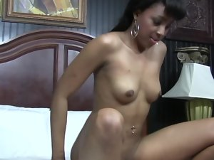 A stunning lustful ebony lassie is stroking a large white penis on the bed