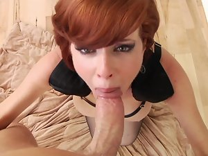 A redhead is getting a filthy load of cum in her luscious petite mouth