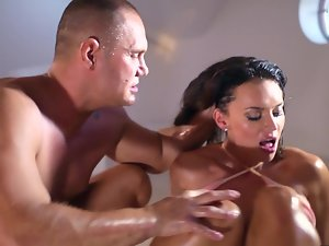 A big naughty ass gal gets oiled up and she is then fondled by her parntner