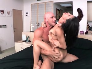A dark haired Latina that has natural knockers is getting her vulva crushed