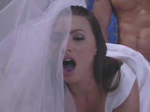 A luscious light-haired in a wedding dress is getting penetrated by a dude