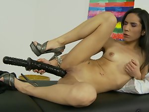 Brunette porn queen testing her twat with a few adult toys