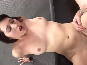 A gaunt cutie with short hair is giving a blow job and is cumshot