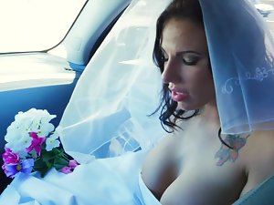 A female gets penetrated in her wedding gown on the bed