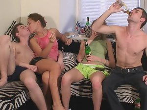 Models are with fellows and they are stroking large penises on the sofa