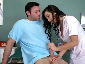 A filthy nurse is taking care of the patients boner in the office