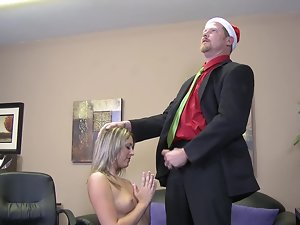 A tempting blonde is in her Christmas hat while she is getting screwed and caressed