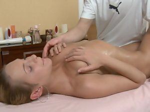 A superb blond is getting her knockers and her cunt caressed on the table