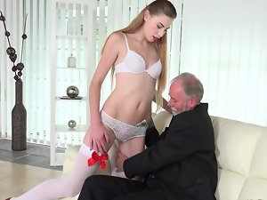 Experienced businessman screws a gorgeous blondie escort on the couch