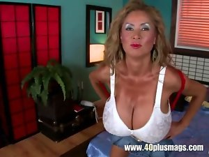 Attractive mature with mega boobs