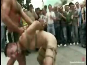 Sick crowd playing with tied up young man