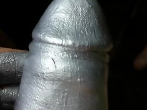 Oiled cock with silver paint