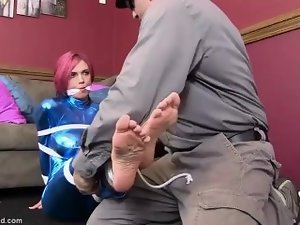 Anna Bell Peaks tied and gagged in blue latex !