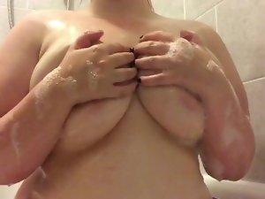 Washing my huge tits in the bath